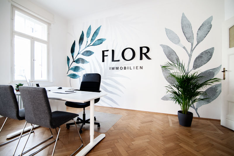 Flor Immobilien Eingang